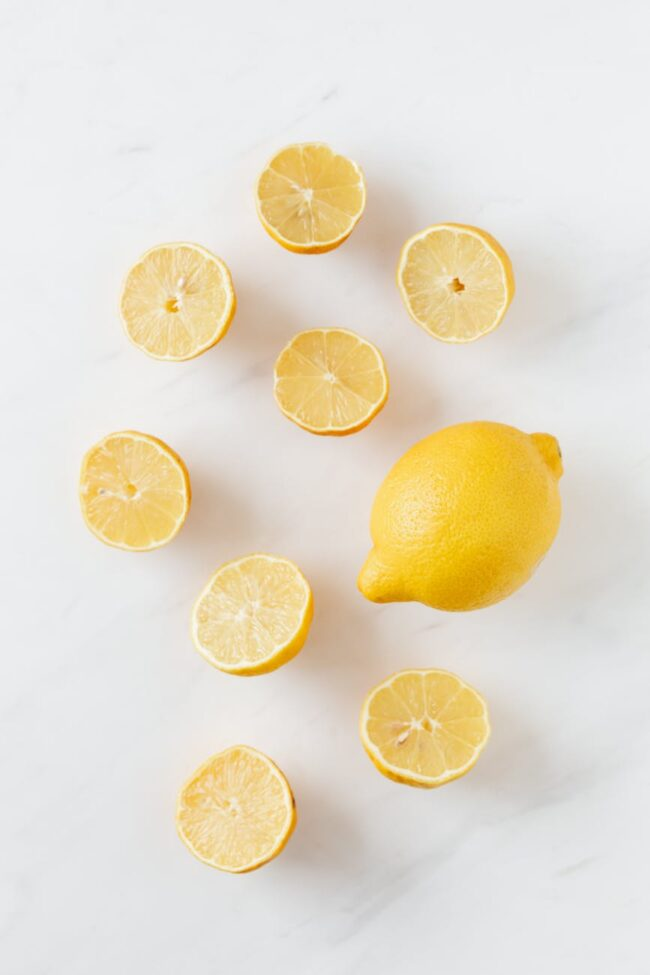 composition of fresh lemons on white surface
