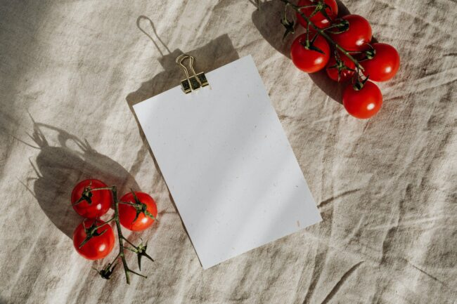 composition of blank clipboard and ripe tomatoes